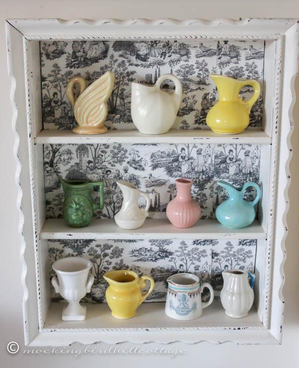 miniature pottery on display