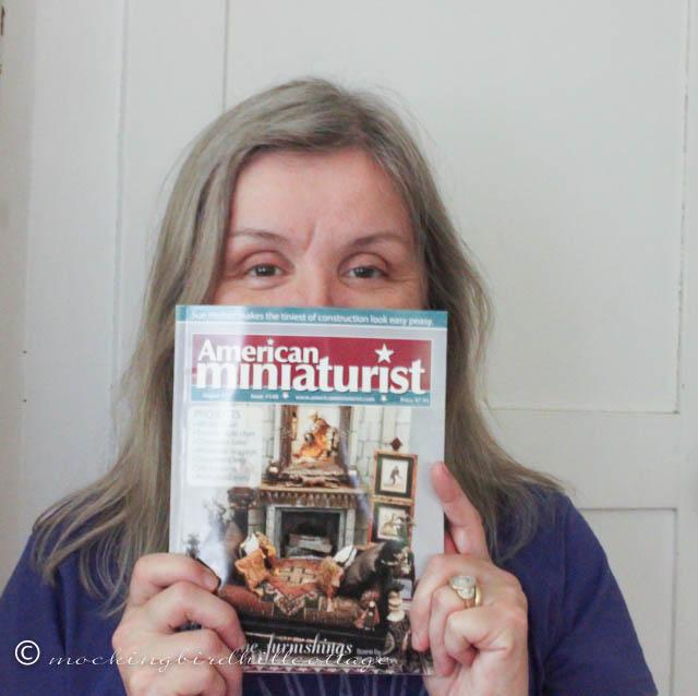 7-18 me holding magazine